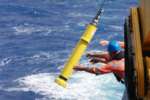 Photo of a scientist deploying an Argo ocean profiler in the Tasman Sea.