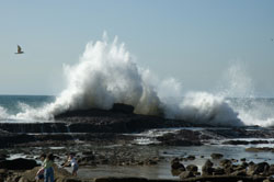 This image shows a wave crashing along the California coast.