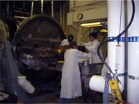 AMR team members prepare instrument for thermal vacuum tests.