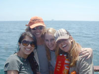 Laura with students on an ocean sampling field trip
